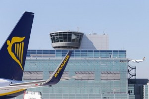 epa06440054 (FILE) - The winglet of a Ryanair plane near the control tower at Frankfurt airport in Frankfurt am Main, Germany, 28 March 2017 (reissued 15 January 2018). Reports on 15 January 2018 state that Frankfurt Rhain/Main airport operating company Fraport hit a record of passenger numbers at Germany's busiest airport in Frankfurt. A total of 64.5 million passengers were handled at Frankfurt Rhein/Main airport in 2017, an increase of 6.1 percent compared to 2016 and mainly due to new competitors like carriers Ryanair or Wizz Air and a plus in cargo handling.  EPA/ARMANDO BABANI *** Local Caption *** 53708928