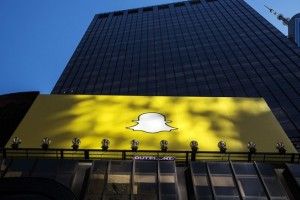 A billboard displays the logo of Snapchat above Times Square in New York March 12, 2015. REUTERS/Lucas Jackson (UNITED STATES - Tags: CITYSCAPE BUSINESS) - RTR4T55E