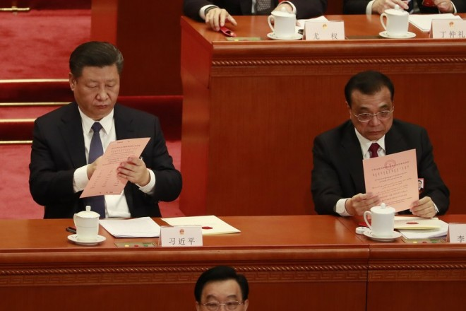epa06595636 Chinese President Xi Jinping (L) and Premier Li Keqiang (R) look at ballot papers during the third plenary session of the first session of the 13th National People's Congress at the Great Hall of the People in Beijing, China, 11 March 2018. Delegates of the NPC will vote on the amendments to the constitution on 11 March including the abolishing of the current presidential term limits. The NPC has over 3,000 delegates and is the world's largest parliament or legislative assembly though its function is largely as a formal seal of approval for the policies fixed by the leaders of the Chinese Communist Party. The NPC runs alongside the annual plenary meetings of the Chinese People's Political Consultative Conference (CPPCC), together known as 'Lianghui' or 'Two Meetings'.  EPA/HOW HWEE YOUNG