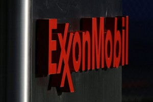"epa03677092 (FILE) A file photo dated 21 July 2010 showing a sign outside an Exxon Mobil Corporation office building in Dallas, Texas. Exxon Mobil, the world's largest publicly traded oil company, reported first-quarter net income of 9.5 billion dollars on 25 April 2013 up just 50 million dollars from the same period a year ago. The company said that revenues sank some 12 per cent to 108 billion dollars from 124 billion dollars a year earlier. The company was hit by lower US prices for oil and gas, but saw profits at its global chemical operations climb 62 per cent in the quarter to 639 million dollars. The company also cited ""favourable tax impacts"" as helping it to retain its profitability despite the steep decline in revenue.  EPA/LARRY W. SMITH"