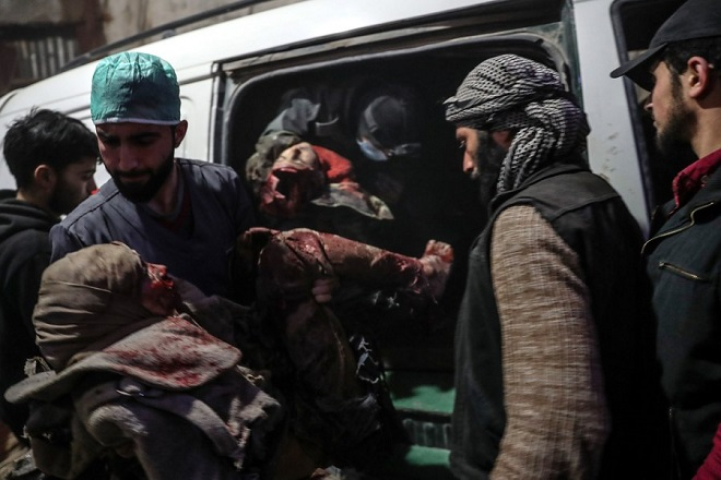 epa06580024 People carry the injured into a hospital after bombing on rebels-held Douma, Eastern Ghouta, Syria, 04 March 2018. At least 31 people got killed today in Douma after bombing allegedly by forces loyal to the Syrian government. Four of them died with their injuries from bombings and shelling that occurred a day earlier.  EPA/MOHAMMED BADRA