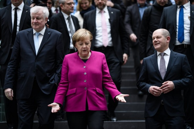 epa06598544 (L-R) Premier of Bavaria and Christian Social Union (CDU) party leader Horst Seehofer, German Chancellor and Christian Democratic Union (CDU) party leader Angela Merkel and Hamburg's First Mayor and acting Social Democratic Party (SPD) leader Olaf Scholz leave after a press conference prior to the signing of the coalition agreement between Christian Democratic Union (CDU), Christian Social Union (CSU) and the Social Democratic Party (SPD) in Berlin, Germany, 12 March 2018. The election of the Federal Chancellor will take place on 14 March 2018 at the Bundestag.  EPA/CLEMENS BILAN
