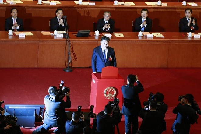epaselect epa06595591 Chinese President Xi Jinping (C) casts his vote during the third plenary session of the first session of the 13th National People's Congress at the Great Hall of the People in Beijing, China, 11 March 2018. Delegates of the NPC will vote on the amendments to the constitution on 11 March including the abolishing of the current presidential term limits. The NPC has over 3,000 delegates and is the world's largest parliament or legislative assembly though its function is largely as a formal seal of approval for the policies fixed by the leaders of the Chinese Communist Party. The NPC runs alongside the annual plenary meetings of the Chinese People's Political Consultative Conference (CPPCC), together known as 'Lianghui' or 'Two Meetings'.  EPA/HOW HWEE YOUNG