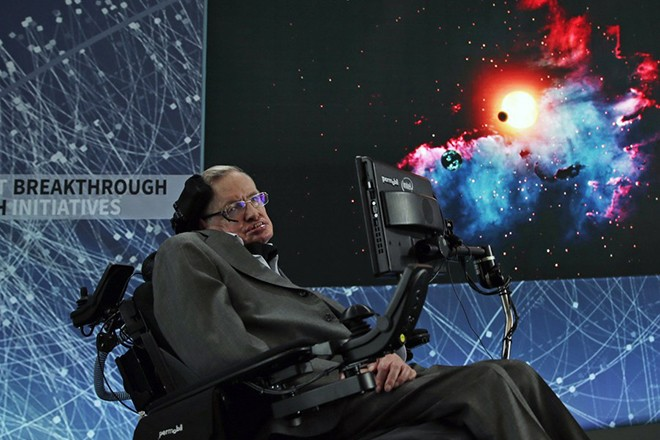 epa06602157 (FILE) - British scientist Stephen Hawking (L) addresses the media while a picture of the cosmos is shown on a video screen during a press conference on top of One World Trade Center in New York, 12 April 2016 (reissued 14 March 2018). British renowned physicist Stephen Hawking has died on early morning of 14 March 2018 at the age of 76, his family announced.  EPA/JASON SZENES