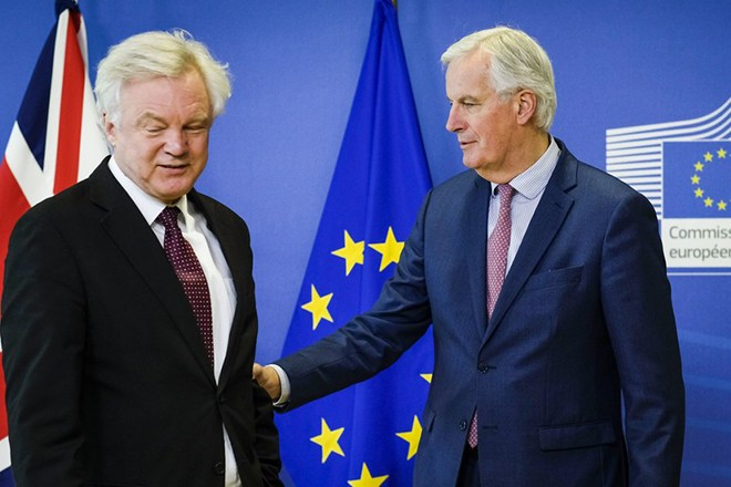 epa06613888 United Kingdom's Secretary of State for Exiting the European Union, David Davis is welcomed by Michel Barnier (R), the European Chief Negotiator of the Task Force for the Preparation and Conduct of the Negotiations with the United Kingdom under Article 50 prior to a meeting in Brussels, Belgium, 19 March 2018. Reports state that David Davis, is in Brussels to meet Michel Barnier during which they hope to finalise a Brexit transition deal.  EPA/OLIVIER HOSLET