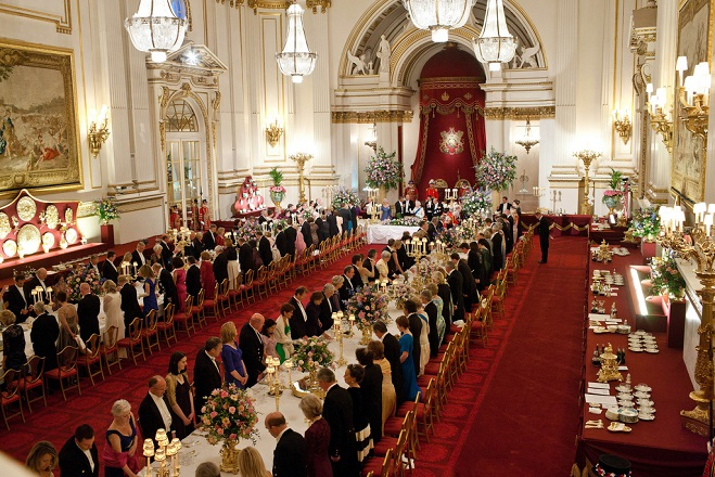 President Barack Obama and First Lady Michelle Obama attend a State Banquet hosted by Queen Elizabeth II at Buckingham Palace in London, England, May 24, 2011. (Official White House Photo by Lawrence Jackson)  This official White House photograph is being made available only for publication by news organizations and/or for personal use printing by the subject(s) of the photograph. The photograph may not be manipulated in any way and may not be used in commercial or political materials, advertisements, emails, products, promotions that in any way suggests approval or endorsement of the President, the First Family, or the White House.