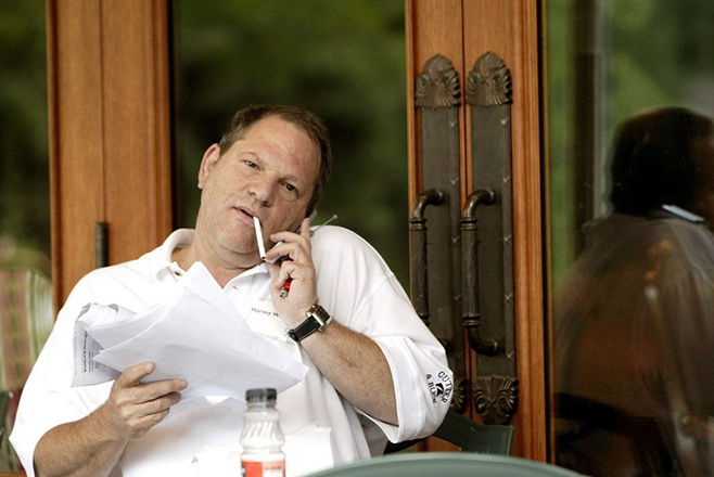 epa06254011 (FILE) - Harvey Weinstein, head of Miramax talks on his mobile phone at the third day of meeting at Allen and Company's 22nd Annual Media Conference in Sun Valley, Idaho, USA, 09 July 2004 (reissued 09 October 2017). According to media reports on 09 October 2017, Hollywood producer Harvey Weinstein was fired from The Weinstein Company, which he co-founded, after additional information surfaced concerning his conduct amid accusations of decades of sexual harassment.  EPA/PETER FOLEY / POOL *** Local Caption *** 00229950
