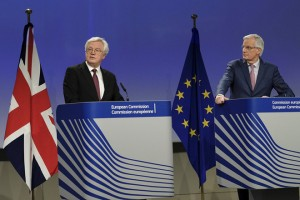 epa06614178 United Kingdom's Secretary of State for Exiting the European Union, David Davis and  Michel Barnier (R), the European Chief Negotiator of the Task Force for the Preparation and Conduct of the Negotiations with the United Kingdom under Article 50 with in Back ground draft of Negotiation agreement during a press briefing after a meeting in Brussels, Belgium, 19 March 2018. Reports state that Michel Barnier and David Davis said they had agreed terms for a transition period.  EPA/OLIVIER HOSLET