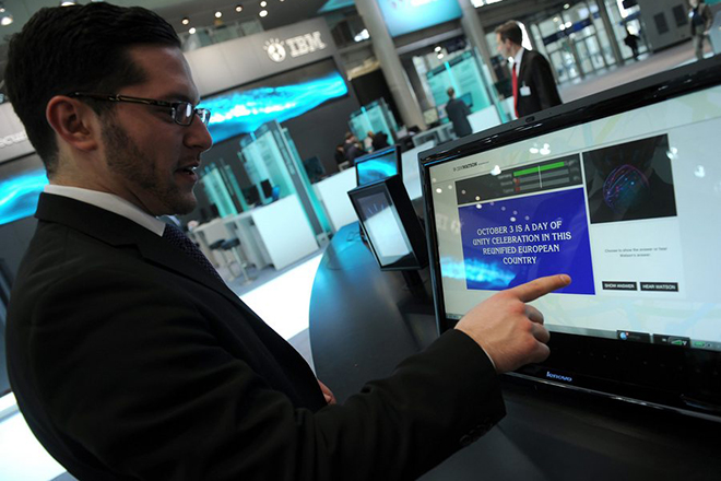 epa02608672 A man interacts with the IBM super computer nicknamed 'Watson' at the CeBIT information technology trade show in Hanover, Germany, 28 February 2011. More than 4,200 companies from 70 countries showcase their latest products at the world's leading computer expo which takes place from 01 to 05 March.  EPA/Caroline Seidel