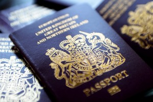 epa04253524 British passports in London, Britain, 13 June 2014. The Home Office has said on 12 July that to help clear the huge backlog of passport applications it will scrap charges for urgent renewals. Some 30,000 people have been impacted by the delays.  EPA/ANDY RAIN