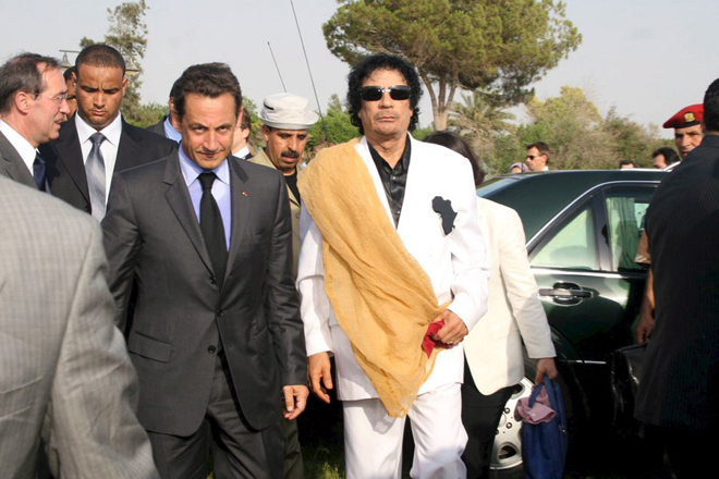 epa06615387 (FILE) - Libyan President Muammar Gaddafi (R) and French President Nicolas Sarkozy at his arrival at Bab Azizia Palace in Tripoli, Libya, 25 July 2007, (reissued 20 March 2018). Media reports on 20 March 2018 state that former French president is being questioned in connection to alleged Libyan financing for his 2007 election campaign.  EPA/SABRI ELMHEDWI