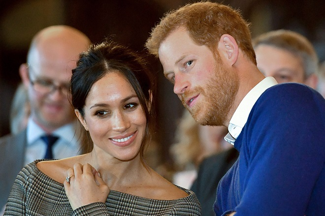 Britain's Prince Harry and his fiancée US actress Meghan Markle watch a dance performance by Jukebox Collective during a visit at Cardiff Castle in Cardiff, south Wales on January 18, 2018, for a day showcasing the rich culture and heritage of Wales. / AFP PHOTO / POOL / Ben Birchall        (Photo credit should read BEN BIRCHALL/AFP/Getty Images)
