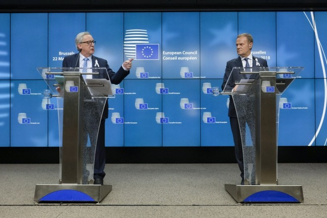 epa06621523 EU Commission President Jean-Claude Juncker (L) and European Council President Donald Tusk (R) speak at a joint news conference during European Council meeting in Brussels, Belgium, 22 March 2018. The spring meeting of the European Council is expected to focus on economic and trade affairs. The Heads of states and governments, according to the Council's agenda, will also look at other pressing issues, including taxation, and the situation in the Western Balkans, Turkey and Russia. The European leaders in an EU 27 format (without Britain) will also discuss the 'Brexit' and 'eurozone' topics.  EPA/ARIS OIKONOMOU / POOL