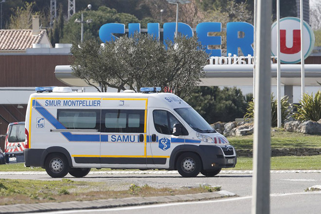 epaselect epa06623694 An ambulance leaves the Super U supermarket where a gunman claiming allegiance to the Islamic State (IS) holding hostages in Trebes, southern France, 23 March 2018. French police are launching a raid on the supermaket where a gunman that allegedly pledged alliance to the IS is holding hostages. Police says at least two people died and dozens were injured in Trebes near Carcassonne.  EPA/GUILLAUME HORCAJUELO