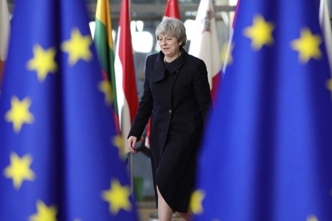 British Prime Minister Theresa May arrives for an EU summit at the Europa building in Brussels on Thursday, Dec. 14, 2017. European Union leaders are gathering in Brussels and are set to move Brexit talks into a new phase as pressure mounts on Prime Minister Theresa May over her plans to take Britain out of the 28-nation bloc. (AP Photo/Olivier Matthys)