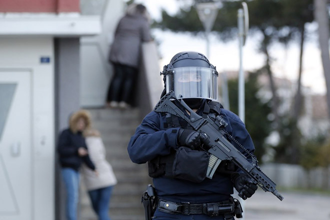 epa06624386 French Police task force BRI (Bureau Recherche Investigation) officers raid the appartment of Redouane Ladkim in the Ozanam district of Carcassonne, southern France, 23 March 2018. Ladkim was identified as the gunman claiming allegiance to the Islamic State (IS) who shot and wounded a jogging police officer before opening fire and taking hostages at a 'Super U' supermarket in the town of Trebes near Carcassonne. Three victims have been confirmed killed and and 16 others dozen injured in the attack.  EPA/GUILLAUME HORCAJUELO