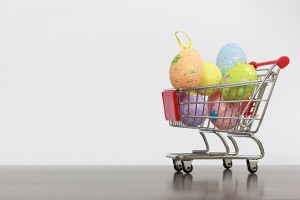 shopping cart with easter eggs for hunting or give away