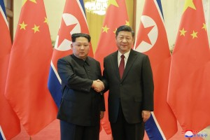 epa06633533 An undated photo released on 28 March 2018 by the North Korean Central News Agency (KCNA), the state news agency of North Korea, shows North Korean leader Kim Jong-un (L) shaking hands with Chinese President Xi Jinping (R) during a visit to China. According to the North Korean media, Kim Jong-un visited China from 25 to 28 March at the invitation of Chinese President Xi Jinping.  EPA/KCNA   EDITORIAL USE ONLY