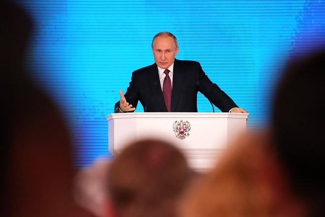 "MOSCOW, RUSSIA - MARCH 01 : (----EDITORIAL USE ONLY  MANDATORY CREDIT - "" RUSSIAN PRESIDENTIAL PRESS AND INFORMATION OFFICE / HANDOUT"" - NO MARKETING NO ADVERTISING CAMPAIGNS - DISTRIBUTED AS A SERVICE TO CLIENTS----)  Russia's President Vladimir Putin delivers an annual address to the Federal Assembly of the Russian Federation, at Moscow's Manezh Central Exhibition Hall; the Federal Assembly of Russia consists of the State Duma of Russia and the Federation Council of Russia in Moscow, Russia on March 01,2018.  (Photo by Russian Presidential Press and Information Office / Handout/Anadolu Agency/Getty Images)"