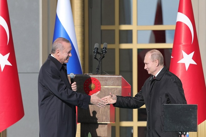 epa06643183 Turkish President Recep Tayyip Erdogan (L) and Russian President Vladimir Putin (R) attend a symbolic ground-breaking ceremony for Turkey's first nuclear power station in Akkuyu, on the Mediterranean, at the Presidential Palace in Ankara, Turkey, 03 April 2018. Putin and Erdogan will also meet with Iranian President Hassan Rouhani in a summit for Syria talks on 04 April.  EPA/TOLGA BOZOGLU