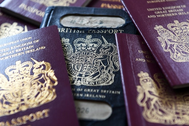 epa06643197 A former blue British passport (C), and the current red EU British passport (L and R) which will be returning to blue when Britain leaves the European Union following an announcement by British Immigration Minister Brandon Lewis on 22 December 2017. News reports on 03 April 2018 state that the British, De La Rue plc, security and anti-counterfeiting provider for banknotes, identity and brand protection, will formally appeal the British government's decision to award the 490 million GBP contract new British passport printing contract to Franco-Dutch  international digital security company Gemalto. The British government has granted a two-week extension in the process to decide who will produce the British passports after Brexit and will be announced on 17 April 2018.  EPA/ANDY RAIN