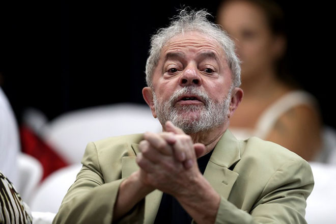 "epa06609546 Brazilian former president Luiz Inacio Lula da Silva participates during the presentation of the book 'La verdad vencera: el pueblo sabe por que me condenan', (The truth will expire - The people know why they condemned me), in Sao Paulo, Brazil, 16 March 2018, (issued 17 March 2018). The book in the result of an interview that he granted in February to a group of journalists and intellectuals and in which he gives his version of the entire judicial process that has him on the verge of imprisonment. Lula say that his possible imprisonment with a sentence of 12 years for corruption will be 'the greatest barbarism' in the history of Brazil because he will be turned into the ""first political prisoner of the country in the 21st century"".  EPA/Fernando Bizerra Jr."
