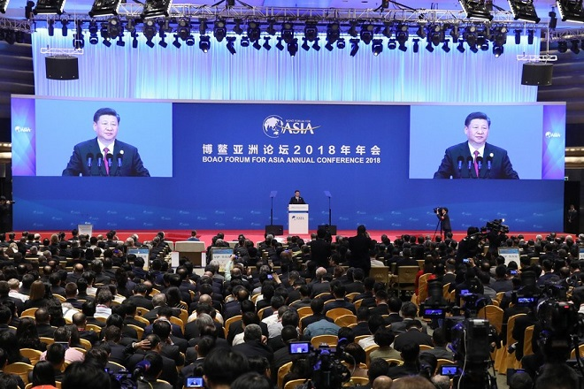 epa06658550 Chinese President Xi Jinping is seen on a screens speaking during the opening of Boao Forum For Asia (BFA) Annual Conference 2018 in Boao, Hainan province, China 10 April 2018. Boao Forum For Asia (BFA) Annual Conference 2018 brings together politicians and business leaders from different countries and is being held in China's Hainan province from 08 until 11 April 2018.  EPA/Stringer CHINA OUT