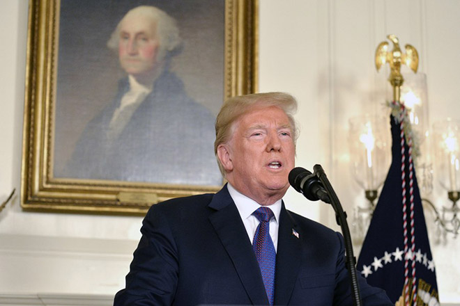 epa06667808 US President Donald J. Trump makes remarks as he speaks to the nation, announcing military action against Syria in response to the recent alleged gas attack on civilians in Douma, at the White House in Washington, DC, USA, 13 April 2018.  EPA/MIKE THEILER / POOL