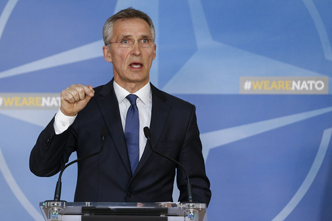 epa06669376 NATO Secretary General Jens Stoltenberg gives a press conference at the end of a meeting of Ambassadors at Nato headquarters in Brussels, 14 April 2018. The objective of the meeting is for France, United States and United Kingdom to update the Council on the latest developments in Syria.  EPA/JULIEN WARNAND