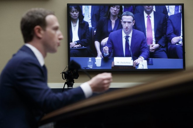 epa06662236 CEO of Facebook Mark Zuckerberg testifies before the House Energy and Commerce Committee hearing on 'Facebook: Transparency and Use of Consumer Data' on Capitol Hill in Washington, DC, USA, 11 April 2018. Zuckerberg is testifying before the second of two Congressional hearings this week regarding Facebook allowing third-party applications to collect the data of its users without their permission and for the company's response to Russian interference in the 2016 US presidential election.  EPA/SHAWN THEW