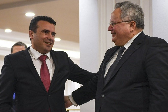 epa06623412 Greek Foreign Minister Nikos Kotzias (R) chats with Macedonian Prime Minister Zoran Zaev (R) after their meeting in Skopje, the Former Yugoslav Republic of Macedonia (FYROM), 23 March 2018. Nikos Kotzias arrived for a two-day official visit to Skopje with a proposal to resolve a long-standing name issue between two neighbouring countries.  EPA/GEORGI LICOVSKI