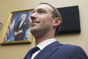 epa06662219 CEO of Facebook Mark Zuckerberg returns from a break in testifying before the House Energy and Commerce Committee hearing on 'Facebook: Transparency and Use of Consumer Data' on Capitol Hill in Washington, DC, USA, 11 April 2018. Zuckerberg is testifying before the second of two Congressional hearings this week regarding Facebook allowing third-party applications to collect the data of its users without their permission and for the company's response to Russian interference in the 2016 US presidential election.  EPA/MICHAEL REYNOLDS
