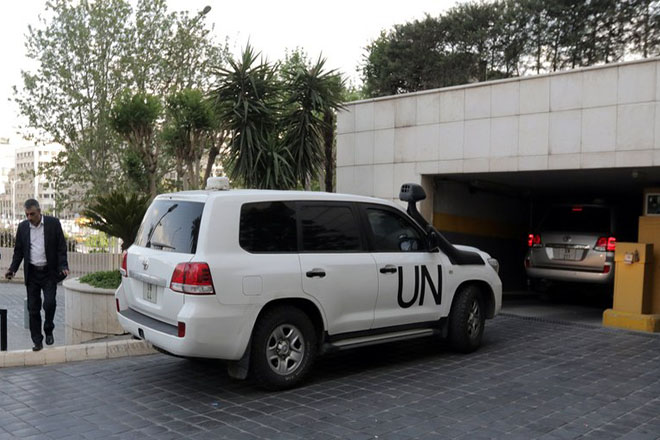 epa06669291 UN vehicles carrying Fact-Finding Mission (FFM) team of the Organization for the Prohibition of Chemical Weapons (OPCW) arrive at the Four Seasons hotel in Damascus, Syria, 14 April 2018. The Organisation for the Prohibition of Chemical Weapons' fact-finding chemical weapons expert team arrived to Damascus to investigate last week's alleged Syrian government chemical attack in the former rebel-held town of Douma, Eastern Ghouta.  EPA/YOUSSEF BADAWI