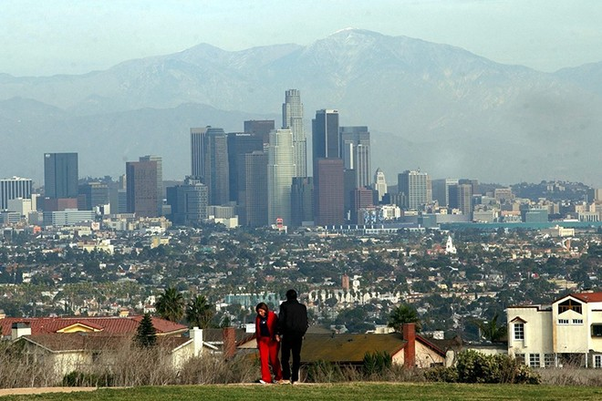 A couple enjoy the clear view of  downtown Los Angeles from the Kenneth Hann park, Friday 28 November 2003. Twenty-eight of California's 58 counties have flunked the American Lung Association's 2003 air quality grading issued earlier this year. Air quality is getting so bad, ground level ozone air pollution now threatens the health of more than 33 million Californians -- virtually everyone in the state, the association claims. The number is up nearly 4 million compared to last year's report. For the fourth straight year, the top four most ozone-polluted metropolitan areas in the nation are in California. They included the Los Angeles-Riverside-Orange County region and three areas of the Central Valley: Fresno; Bakersfield; and Visalia-Tulare-Porterville. Also in the top 25 most polluted areas are Sacramento-Yolo at sixth place followed by Merced and then San Diego at number 20.  EPA/ARMANDO ARORIZO