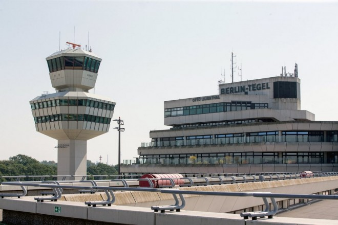 epa06225136 (FILE) -The tower (L) and the main building (R) pictured from the visitor's terrace of Berlin-Tegel Otto Lilienthal airport in Berlin, Germany, 30 August 2017 (reissued 24 September 2017). A majority of Berlin residents on 24 September 2017 voted in a non-binding referendum to keep Berlin Tegel Otto Lilienthal airport open, preliminary results show. Tegel airport is scheduled to be closed six months after the opening of still-under-construction Berlin Brandenburg International (BER) airport.  EPA/ALEXANDER BECHER *** Local Caption *** 53734233