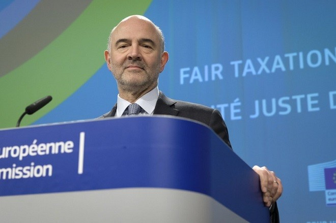 epa06617484 Pierre Moscovici, the European Commissioner for Economic and Financial Affairs, Taxation and Customs gives a press conference in Brussels, Belgium, 21 March 2018 , to present new measures to ensure that digital business activities are taxed in a fair way in the EU.  EPA/OLIVIER HOSLET