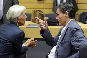 epa04843550 International Monetary Fund (IMF) Managing Director Christine Lagarde (L) and Greek Finance Minister Euclid Tsakalotos talk at the start of a special Eurogroup finance ministers meeting on the Greek crisis, at the European Council headquarters in Brussels, Belgium, 12 July 2015. Eurozone Finance Ministers set 12 July 2015 as the deadline to reach an agreement saving Greece from bankruptcy, amid warnings that failure to strike a deal by then could lead the country to crash out of the eurozone.  EPA/LAURENT DUBRULE