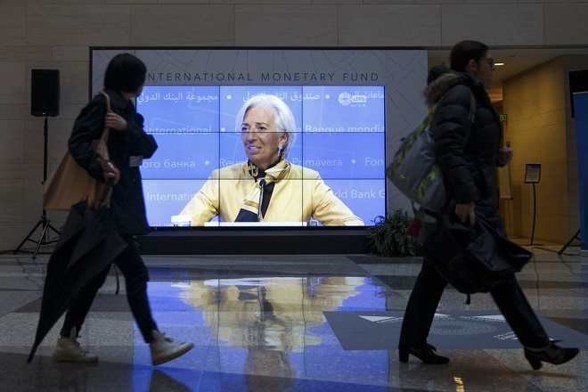 epa06679505 IMF Managing Director Christine Lagarde, seen on a screen in the lobby, responds to a question from the news media during her opening press conference at the IMF Headquarters in Washington, DC, USA, 19 April 2018. 2018 International Monetary Fund World Bank Group Spring Meetings run through 17-21 April 2018.  EPA/SHAWN THEW