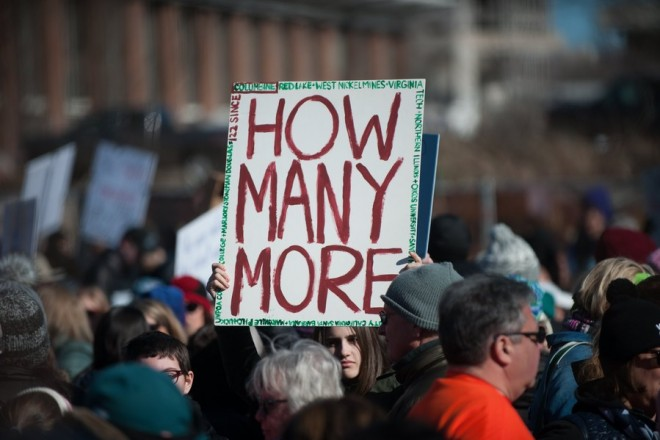 epa06626682 A participant holds a sign 'How Many More' during the March For Our Lives in Philadelphia, Pennsylvania, USA, 24 March 2018. March For Our Lives was organized in response to the 14 February shooting at Marjory Stoneman Douglas High School in Parkland, Florida. The student activists demand that their lives and safety become a priority, and an end to gun violence and mass shootings in schools.  EPA/TRACIE VAN AUKEN