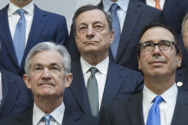 epa06681818 President of the Central European Bank Mario Draghi participates in the G20 family photo during the 2018 World Bank Group IMF Spring Meetings at IMF Headquarters in Washington, DC, USA, 20 April 2018. 2018 International Monetary Fund World Bank Group Spring Meetings runs 17-21 April 2018.  EPA/SHAWN THEW
