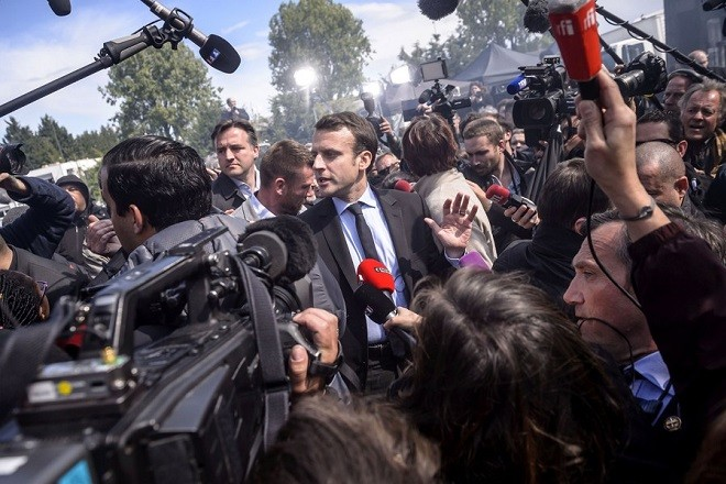 epa06680386 (FILE) A file picture dated 26 April 2017 shows French presidential election candidate for the 'En Marche!' (Onwards!) political movement, Emmanuel Macron (C) arriving to meet with employees of the Whirlpool plant in Amiens, northern France. The first anniversary of Macron's presidency will be marked on 07 May 2018. The chaotic demonstration when Emmanuel Macron met with employees of the Whirlpool plant remains one of the standout moments of the presidential campaign.  EPA/CHRISTOPHE PETIT TESSON ATTENTION: This Image is part of a PHOTO SET