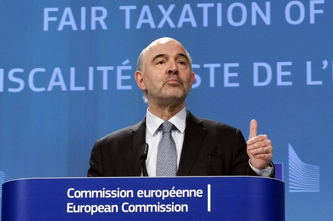 epa06617468 Pierre Moscovici, the European Commissioner for Economic and Financial Affairs, Taxation and Customs gives a press conference in Brussels, Belgium, 21 March 2018 , to present new measures to ensure that digital business activities are taxed in a fair way in the EU.  EPA/OLIVIER HOSLET