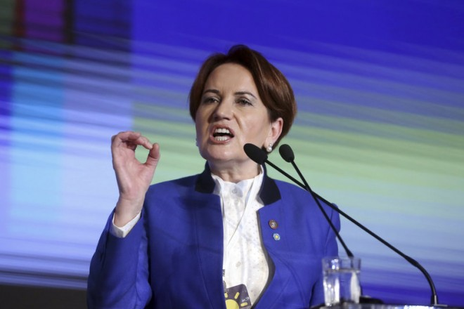 "Meral Aksener, a former Turkish interior minister and deputy parliament speaker, addresses her party's first meeting in Ankara, Turkey, Wednesday, Oct. 25, 2017. Hoping to challenge President Recep Tayyip Erdogan in elections set for 2019, Aksener founded the center-right ""Iyi Parti,"" or ""Good Party,"" in Ankara with a group of legislators who broke away from Turkey's nationalist party this year. (Depo Photos via AP)"