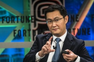 epa06370631 Pony Ma, chairman and chief executive officer of Tencent, speaks during the Fortune 500 Global Forum in Guangzhou, Guandong Province, China, 06 December 2017. Ma Huateng, also known as Pony Ma, is a Chinese business magnate, investor, philanthropist, engineer, internet and technology entrepreneur. He is the founder, chairman and chief executive officer of Tencent, Asia's most valuable company, one of the largest investment corporations and Internet companies, and the biggest gaming and entertainment company in the world.  EPA/ALEKSANDAR PLAVEVSKI