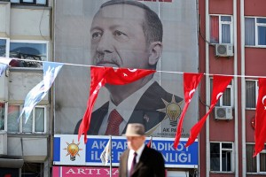 epa06679391 A man walks under a huge picture of Turkish President Recep Tayyip Erdogan in Istanbul, Turkey, 19 April 2018. The presidental and parliamentary elections were scheduled to be held in November 2019, but government has decided the change the date following the recommendation of the Nationalist Movement Party (MHP) leader Devlet Bahceli.  EPA/ERDEM SAHIN