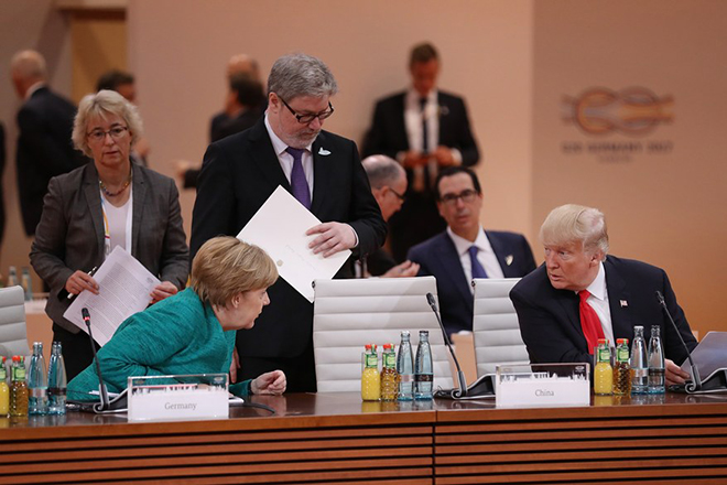 epa06075573 German Chancellor Angela Merkel (L) and US President Donald Trump attend the morning working session on the second day of the G20 economic summit in Hamburg, Germany 08 July 2017. The G20 Summit (or G-20 or Group of Twenty) is an international forum for governments from 20 major economies. The summit is taking place in Hamburg 07 to 08 July 2017.  EPA/SEAN GALLUP / POOL