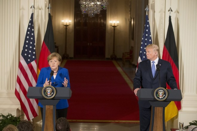 epa06697724 US President Donald J. Trump (R) and Chancellor of Germany Angela Merkel (L) hold a joint news conference in the East Room of the White House in Washington, DC, USA, 27 April 2018. Merkel is on a one-day working visit to the White House where she and President Trump were expected to discuss trade issues such as proposed US tariffs on European steel and aluminum products, in addition to topics such as NATO.  EPA/MICHAEL REYNOLDS