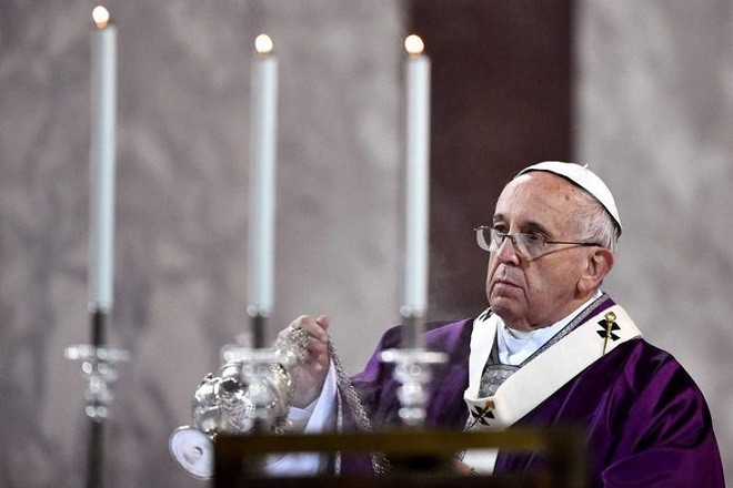 Pope Francis leads the Ash Wednesday mass opening Lent, the forty-day period of abstinence and deprivation for Christians, before Holy Week and Easter on February 18, 2015 at Santa Sabina church in Rome.   AFP PHOTO POOL / GABRIEL BOUYSGABRIEL BOUYS/AFP/Getty Images