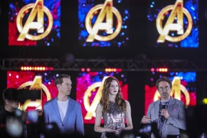 epa06673076 British actor Benedict Cumberbatch (L), Scottish actress Karen Gillan (C) and US actor Robert Downey Jr (R) are pictured against the Avengers logo during the 'Avengers: Infinity War' movie fan event at the Marina Bay Sands hotel in Singapore, 16 April 2018. 'Avengers: Infinity War' features an ensemble cast from the Marvel Cinematic Universe and will premiere worldwide on 23 April.  EPA/WALLACE WOON