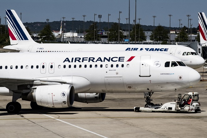 epa06716875 Planes of French airline Air France are parked on the tarmac on the Charles de Gaulle Airport in Paris, France, 07 May 2018. Facing a large mobilization of the company workers, Air France-KLM CEO Jean-Marc Janaillac announced his desire to hand his resignation, allegedly after the May 15 council according to a press declaration.  EPA/ETIENNE LAURENT